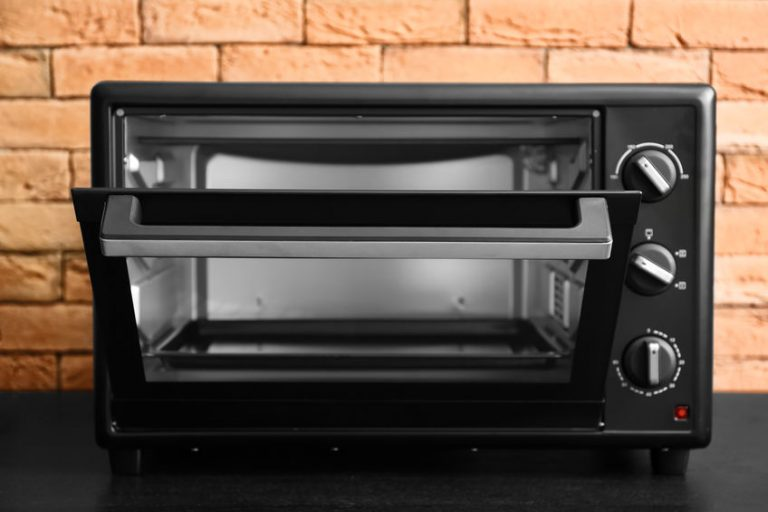 Modern electric oven on dark table